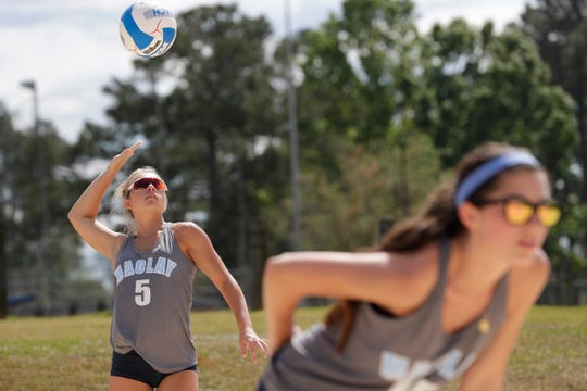 Maclay senior Addison Lewis serves during the preseason beach volleyball classic at Tom Brown Park Monday, March 25, 2019.