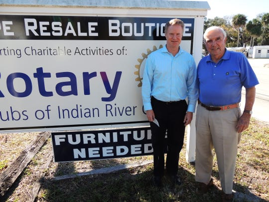 Vero Beach Rotary Club President Mike Kanuka, left, accepts a $7,000 check from Warren Schwein, philanthropist and trustee of the foundation that owns the Hope Resale Boutique.