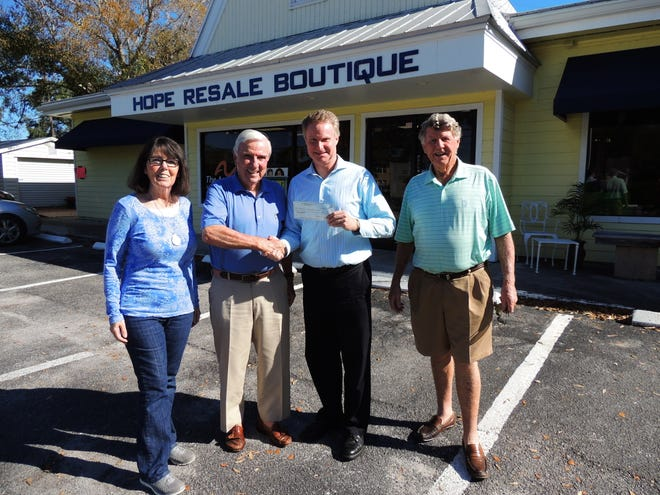 Hope Resale Boutique Manager Colleen Flaherty, left, Warren Schwein, philanthropist and trustee of the foundation that owns the shop, presents a $7,000 check to Vero Beach Rotary Club President Mike Kanuka and John Meilke, Rotarian and property manager.