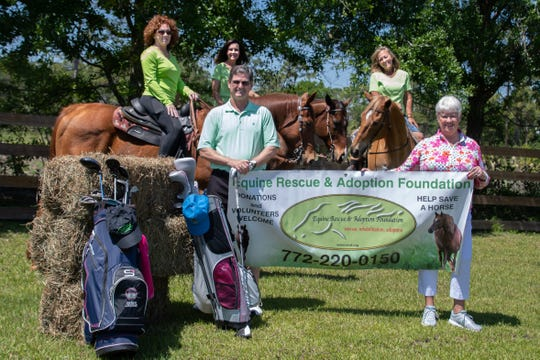 Sponsor Todd Weissing, front, left, of Merrill Lynch in Stuart and Equine Rescue and Adoption Foundation Treasurer Marilynn Vannucci display the agency's banner in front of board President Denise LeClair-Robbins, board member Brenda Weissing and staff member Michele Potts, showing off some of the rescue horses.