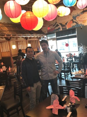 P.J. Liu, left, and John Lee are business partners and friends. They own the Sunny's Sushi restaurants and about 12 other restaurants in the Southwest.