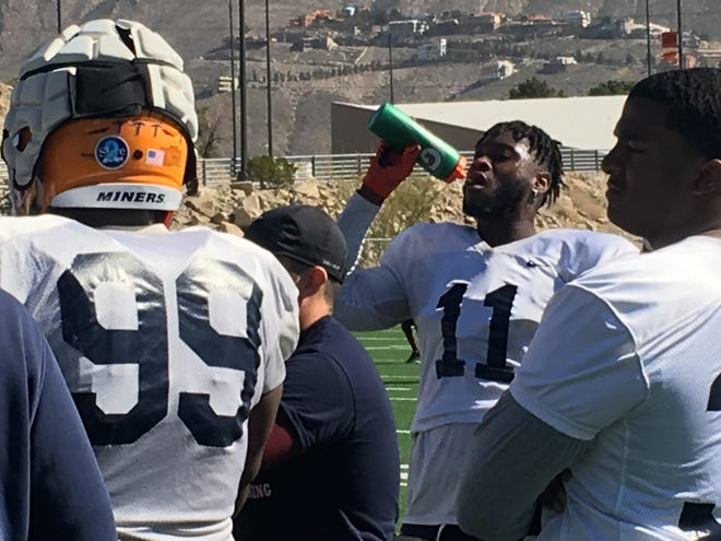 Denzel Chukwukelu takes a drink during Monday's spring football practice