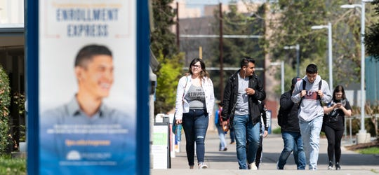 "Students Ariana Reyes, left, Salvador Garcia and Gabriel Espino traverse the College of the Sequoias campus on Monday, March 25, 2019. All three are former VUSD high school students. Enrollment of VUSD students at COS has climbed more than 20% since 2014 to 775 for the fall semester. VUSD and COS offer dual-enrollment and concurrent classes to help students gain college credit while also meeting requirements to graduate from high school. The programs are beneficial to help ""bridge the cap"" from high school to college, according to VUSD administrators."