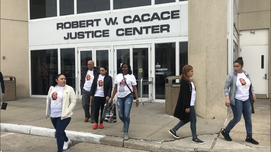 Leonidas Casado, center, whose daughter was fatally shot in January 2017 in Yonkers, leaves city court with relatives and friends following appearance by suspect Luis Alturet Rivera, her daughter's boyfriend. Rivera is not charged in the killing but was charged with possessing Diana Casado's credit cards near where she was killed and around the time of the killing.