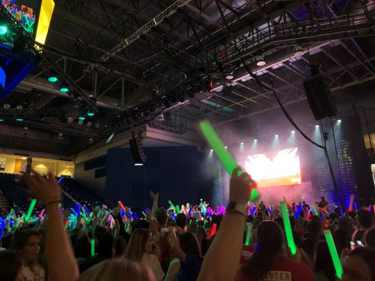Rave hour, the 12th hour of UDance, gets the crowd excited with loud music and lights before the final fundraising reveal.