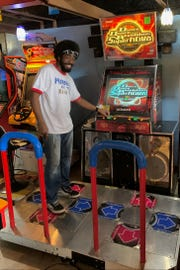 Maniac Mansion owner Marcus McGee is seen with some of the arcade games that will be at the new venue.