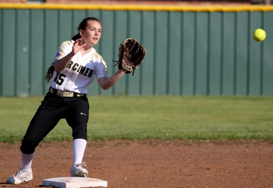 Archer City's Aspyn Huseman gets the force out at second against Petrolia Monday, March 25, 2019, in Archer City.