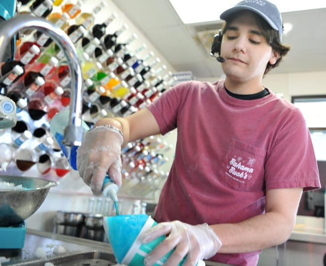 Wichita Falls Bahama Buck's manager Alec Riding-In makes a Blue Cotton Candy flavored Sno, Monday afternoon. Bahama Bucks and St. Jude Children's Hospital are working together to help battle childhood cancer, and other life-threatening illnesses, according to a press release.