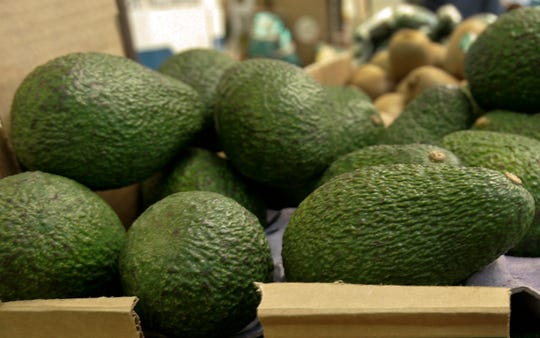 """In this Jan. 17, 2007 file photo, California-grown avocados are for sale at a market in Mountain View, Calif. Henry Avocado, a grower and distributor based near San Diego, said Saturday, March 23, 2019, they are voluntarily recalling their California grown """"Henry"""" labeled whole avocados distributed across the U.S. over possible listeria contamination. Henry Avocado says it issued the voluntary recall after a routine inspection of its packing plant revealed samples that tested positive for listeria. The company says avocados imported from Mexico and distributed by Henry are not being recalled and are safe. There have been no reports of any illnesses associated with the items. (AP Photo/Paul Sakuma, File)"""