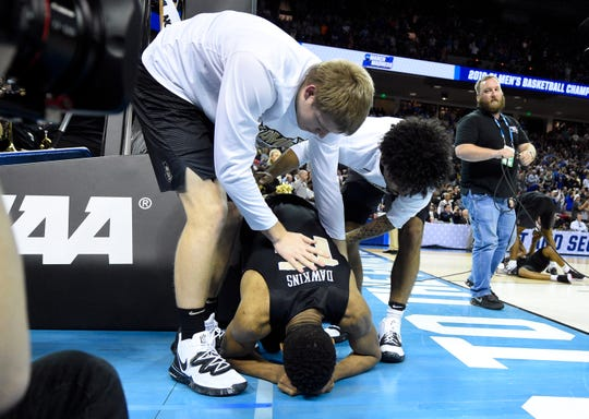 UCF guard Aubrey Dawkins (15) reacts after being defeated by Duke.