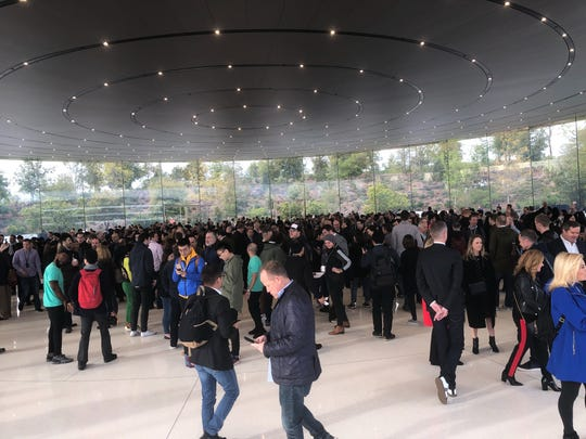 The press gather at the Steve Jobs Theater for Apple's `Showtime' media event.