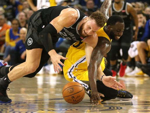 954de8d4b March 24  Pistons forward Blake Griffin and Warriors forward Draymond Green  scramble for a loose