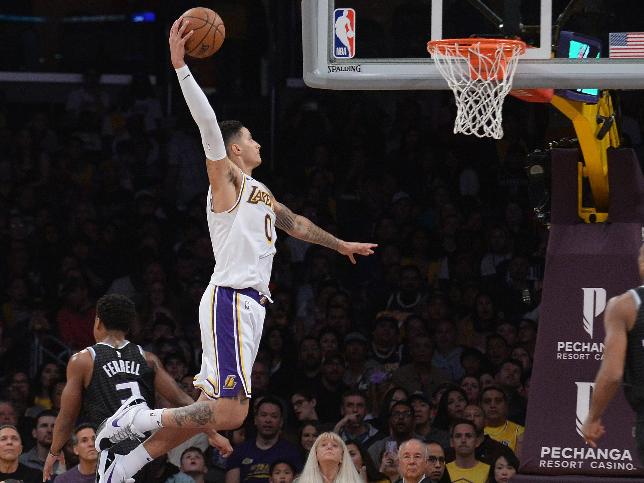 March 24: Lakers forward Kyle Kuzma soars to the hoop for the one-handed flush against the Kings.