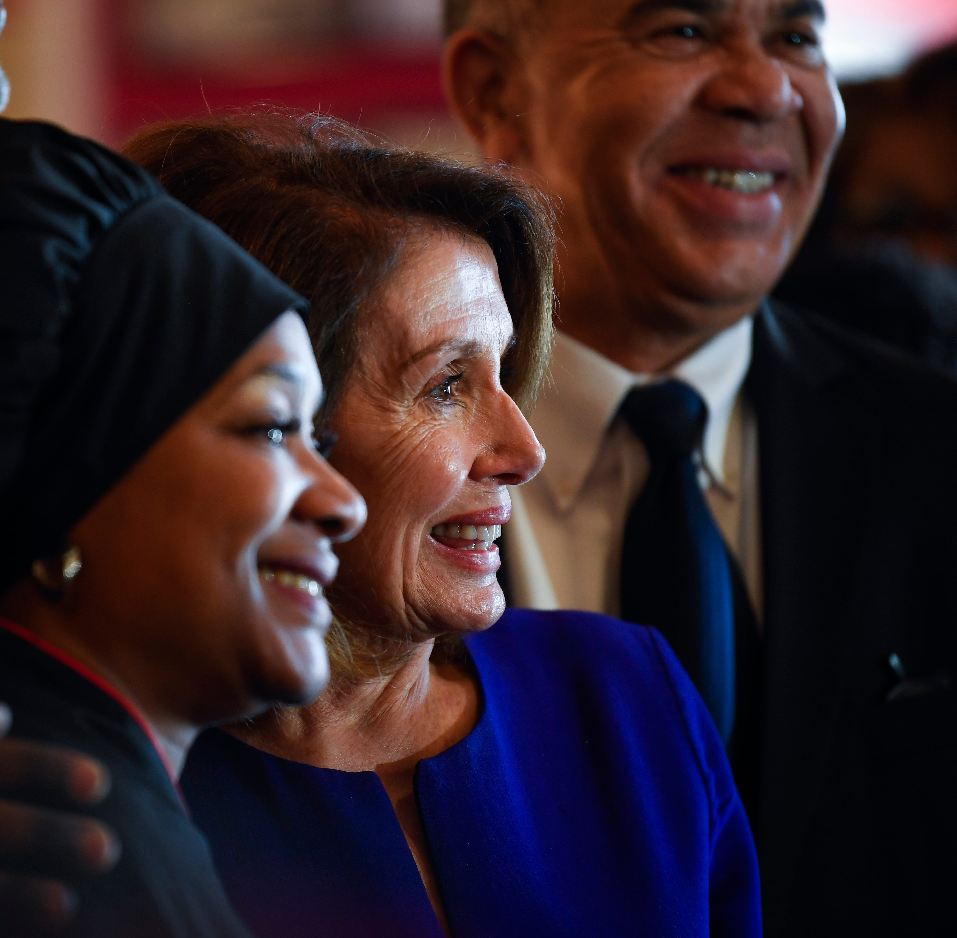 Speaker of the House Nancy Pelosi with Cathy Jenkins, the owner of Cathy's Kitchen in Ferguson, Mo. Rep. Lacy Clay, who represents Ferguson, is in the background.