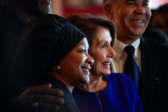 Speaker of the House Nancy Pelosi with Cathy Jenkins, the owner of Cathy's Kitchen in Ferguson, Mo. Rep. Lacy Clay, who represents Ferguson, is in the background March 18, 2019.