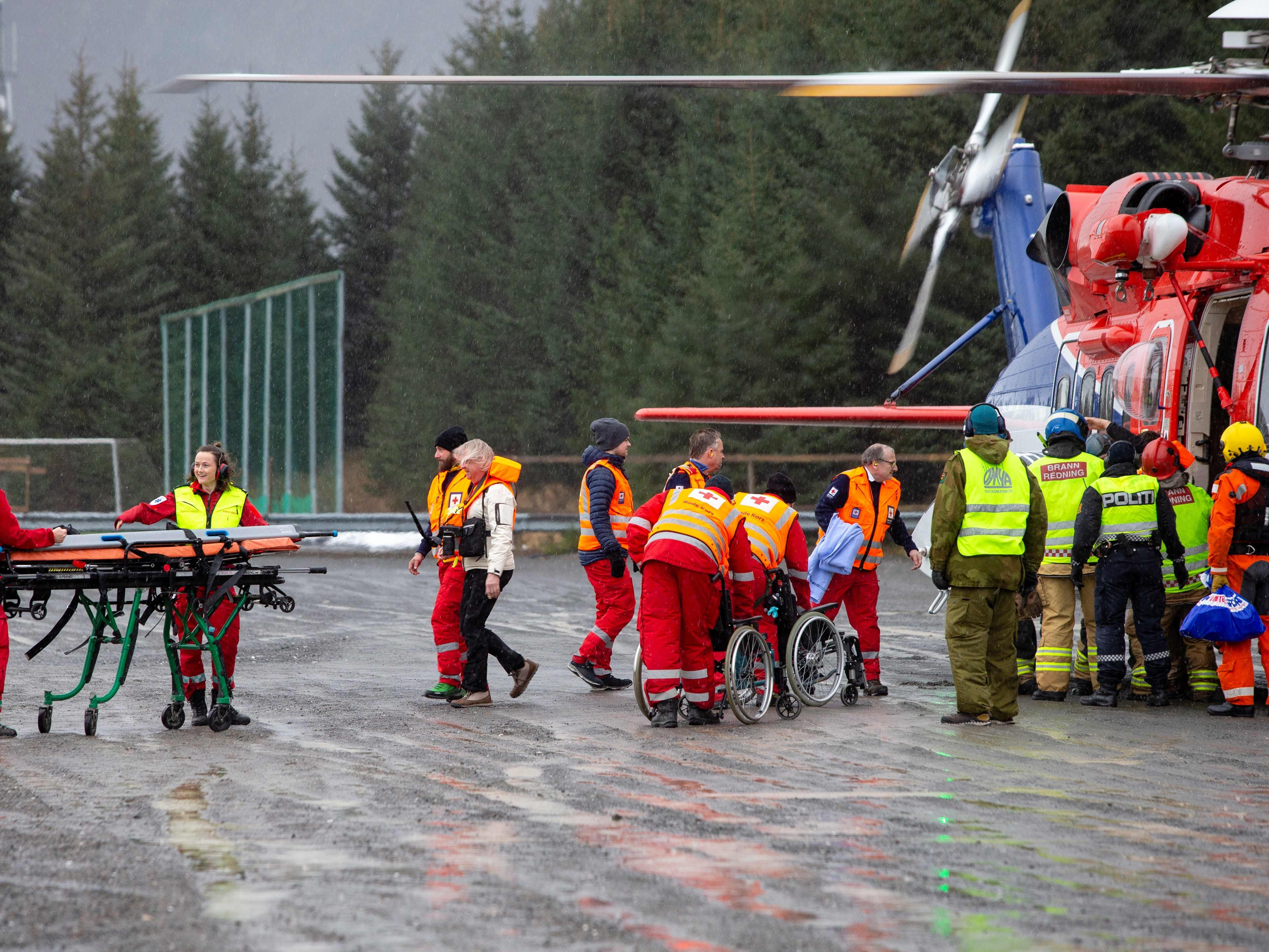 Rescuers wait to assist passengers who were evacuated from the Viking Sky on March 24, 2019.