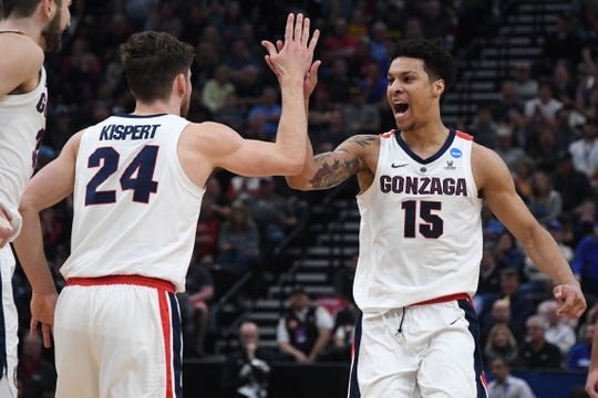 Gonzaga Bulldogs forward Brandon Clarke (15) reacts with forward Corey Kispert (24) during the first half in the second round of the 2019 NCAA Tournament against the Baylor Bears at Vivint Smart Home Arena.