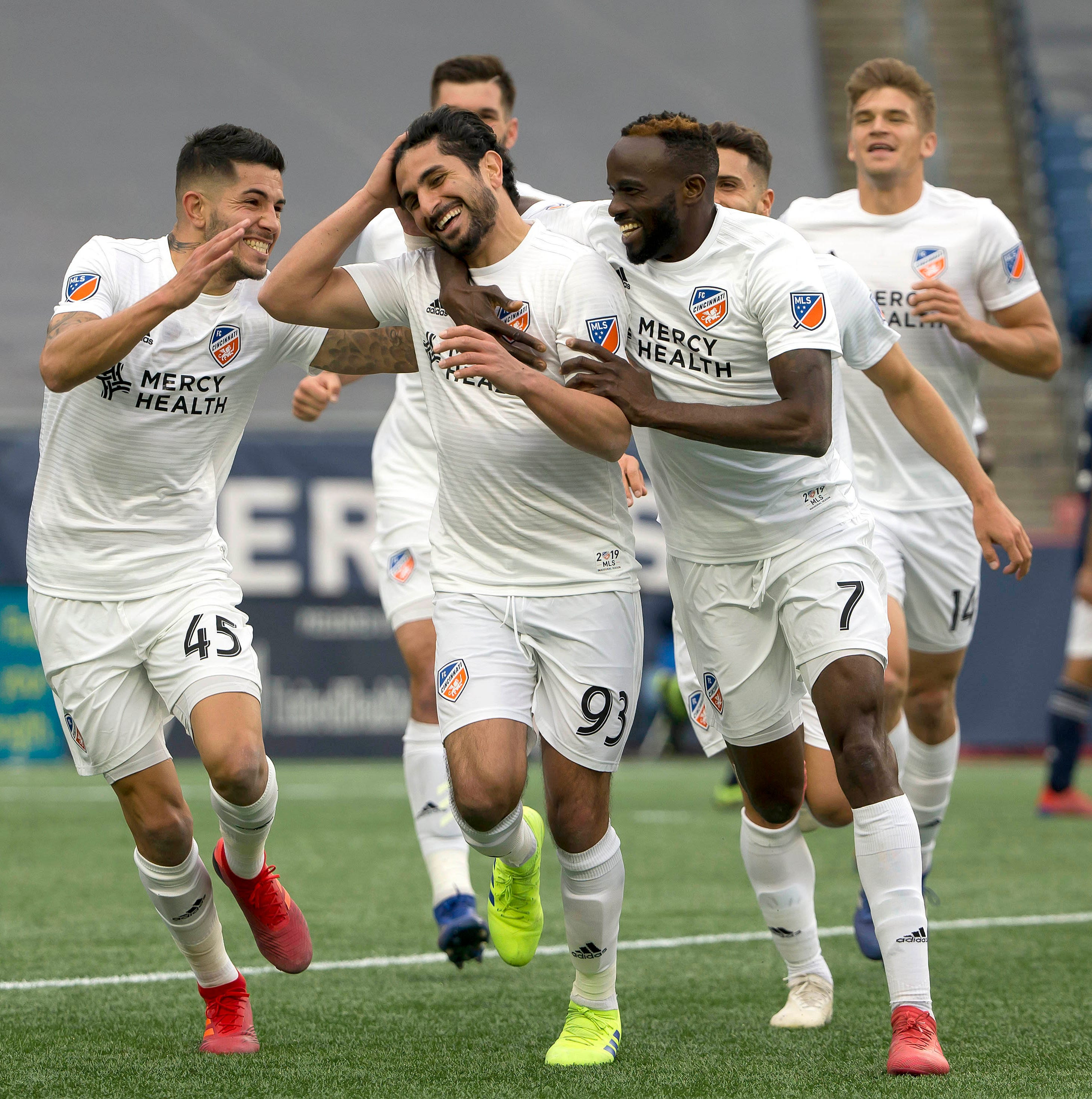 March 24: FC Cincinnati midfielder Kenny Saief (93) is congratulated by teammates after his goal against the New England Revolution at Gillette Stadium. Cincinnati won the game, 2-0.