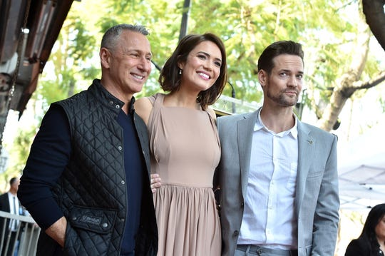 """""""A Walk to Remember"""" director Adam Shankman, Mandy Moore, and Shane West attend the star ceremony for Moore on March 25."""