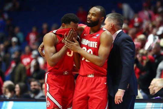 Ohio State's C.J. Jackson, left, and Keyshawn Woods react after coming off the court for the final time of their college basketball careers during a 74-59 loss to Houston Sunday night in Tulsa in the second round of the NCAA Tournament.