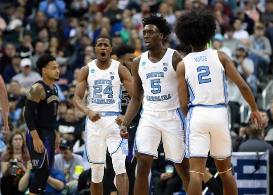 North Carolina Tar Heels guard Kenny Williams (24) celebrates with striker Nassir Little (5) and guard Coby White (2) against the Washington Huskies in the second round of the 2019 NCAA tournament in the Nationwide Arena.