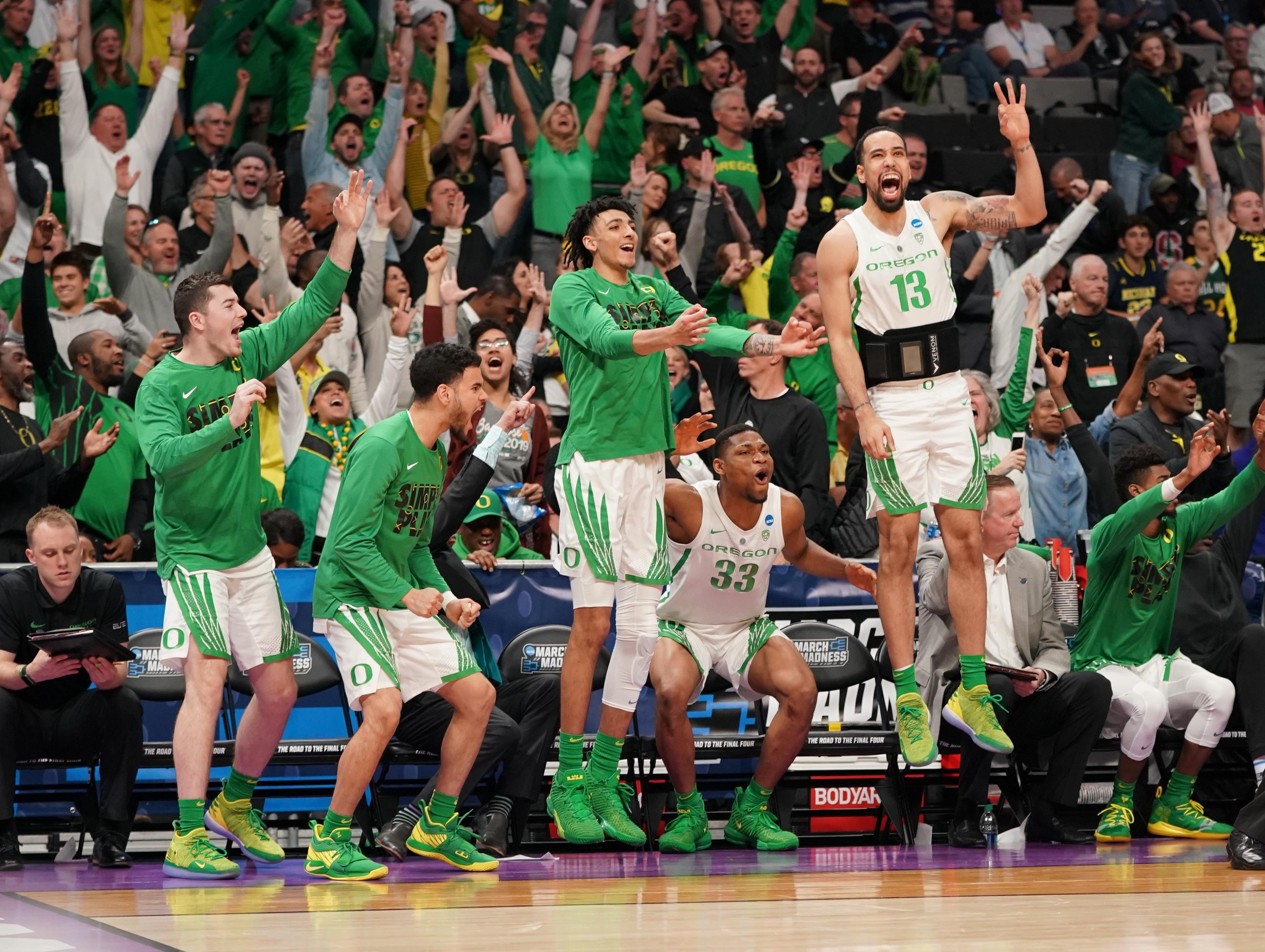 Round of 32: The Oregon Ducks bench celebrates a 3-pointer during the second half against the UC Irvine Anteaters.