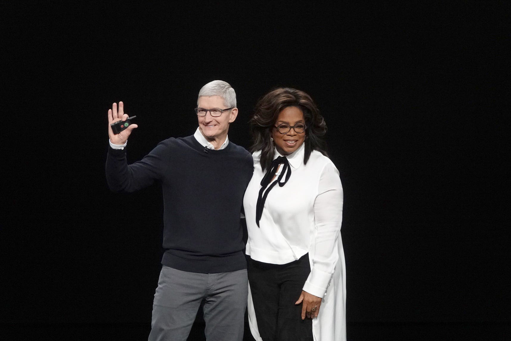 Apple chief Tim Cook with Oprah Winfrey at Apple's unveiling of its streaming plans in Cupertino, California, Monday.