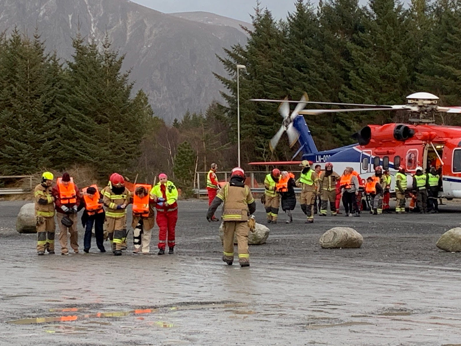 Passengers arrive in Hustadvika, Norway, after being airlifted from the Viking Sky on March 23, 2019.