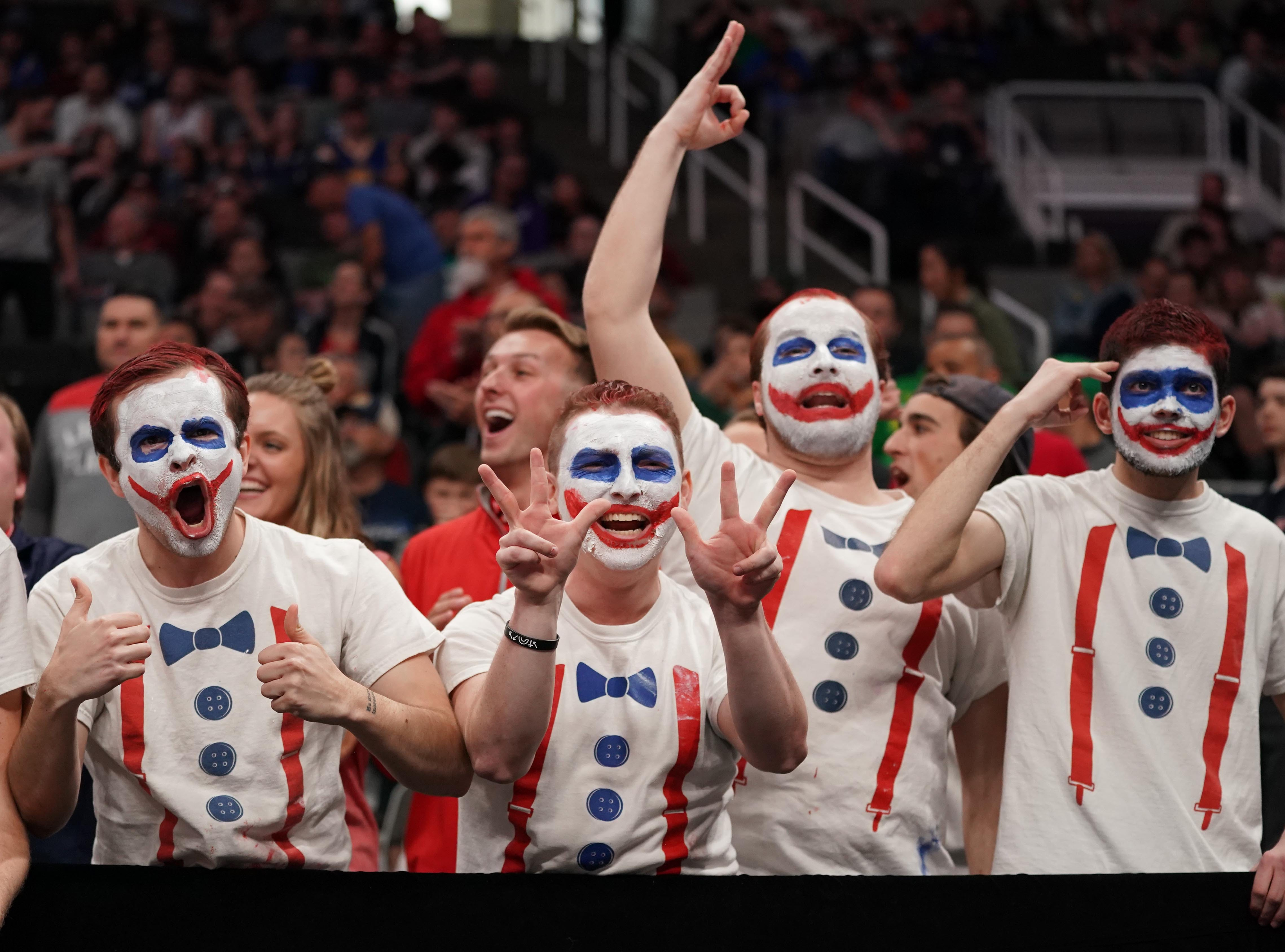 Round of 32: Liberty Flames fans cheer during the first half.