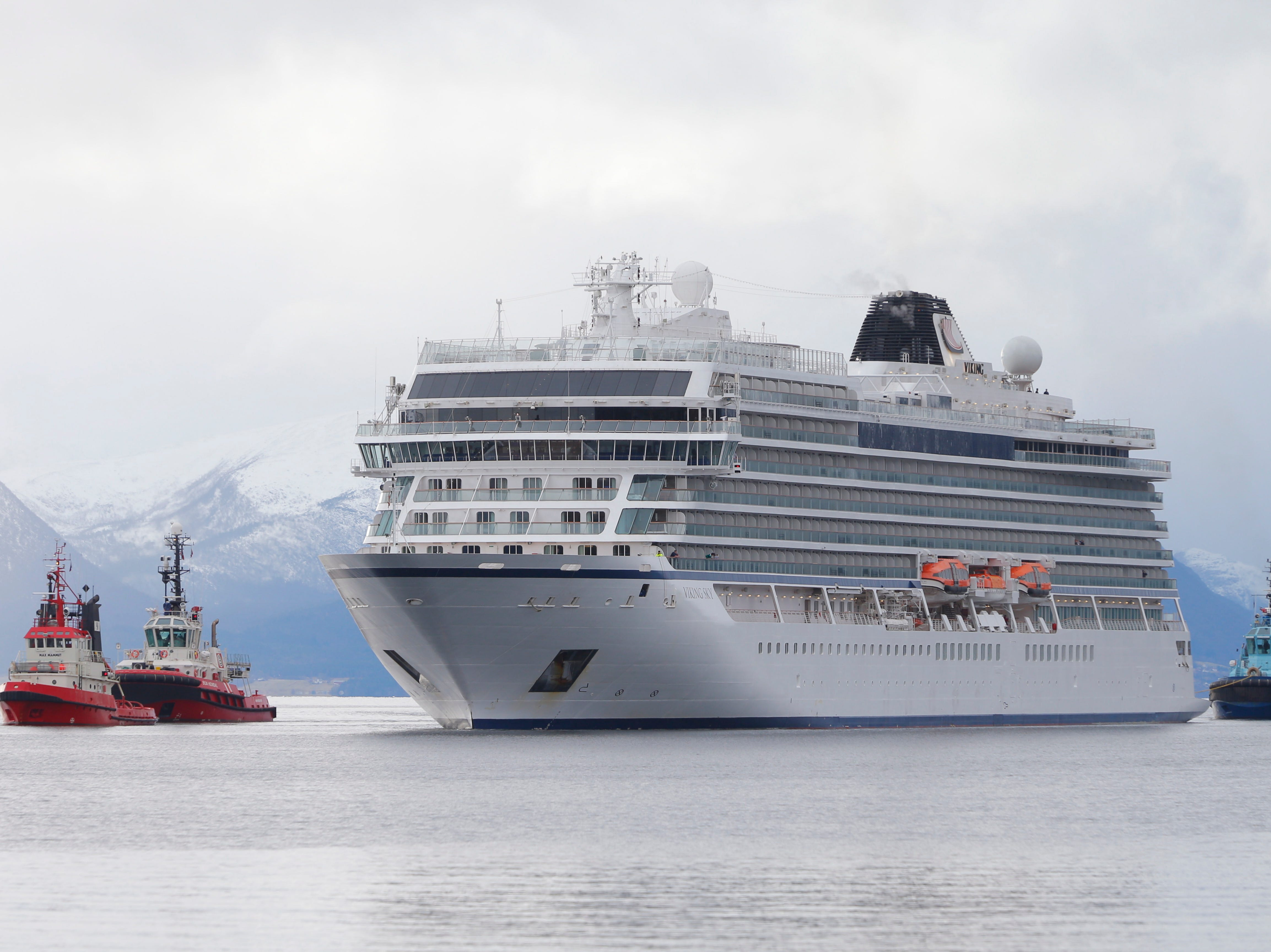 Escorted by tugboats, the Viking Sky arrives at Molde, Norway, on March 24, 2019. The cruise ship reported engine failure in windy conditions off the west coast of Norway on March 23.