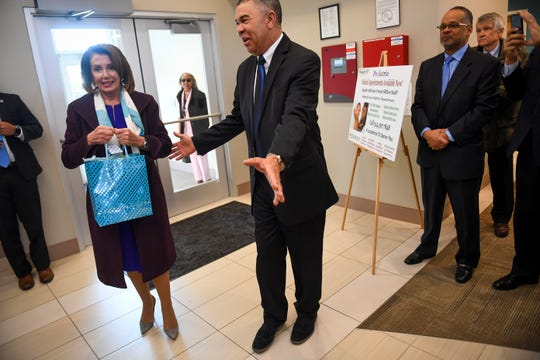 Speaker of the House Nancy Pelosi arrives to take a tour of the Lacy Clay Center for Children's Health in St. Louis, Mo. March 18, 2019, along with Congressman William Lacy Clay, D-Mo. right. Pelosi is holding a gift from Clay, which includes dark mint chocolates.-