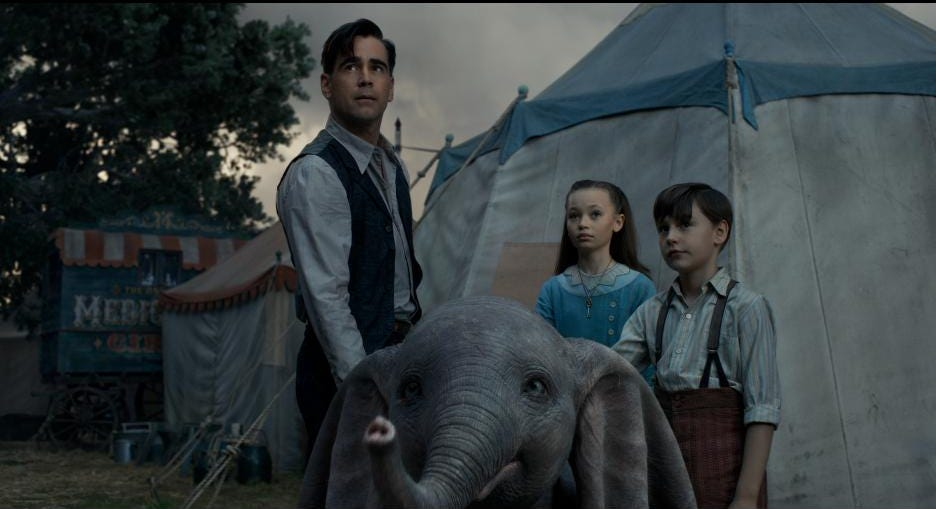 """Holt Farrier (Colin Farrell, left) and his children, Milly (Nico Parker) and Joe (Finley Hobbins), get protective of a baby elephant in """"Dumbo."""""""