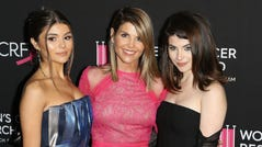 Olivia Jade, Lori Loughlin and Isabella Gianulli arrive together at a 2019 event in Hollywood.