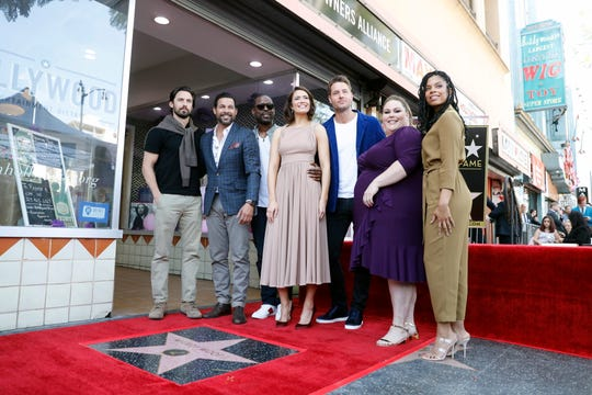 """Mandy Moore poses with her co-stars of the show """"This is Us"""" Milo Ventimiglia, Jon Huertas, Sterling K. Brown, Justin Hartley, Chrissy Metz and Susan Kelechi Watson at her star ceremony."""