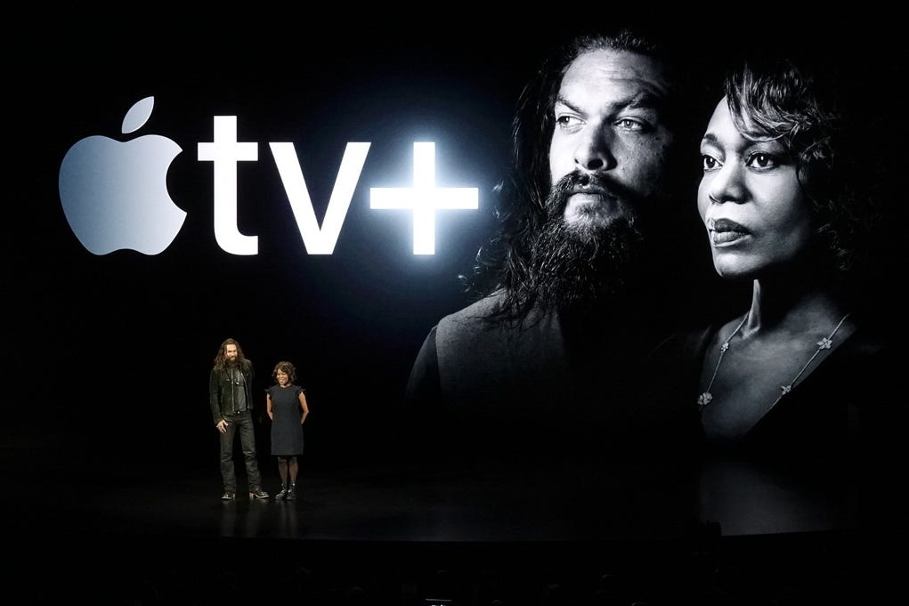 Actors Jason Momoa, left, and Alfre Woodard speak at the Steve Jobs Theater during an event to announce new Apple products on March 25, 2019, in Cupertino, Calif.