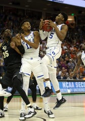 Duke Blue Devils forward RJ Barrett (5) comes down with the rebound against the UCF Knights during the second half in the second round of the 2019 NCAA Tournament at Colonial Life Arena.
