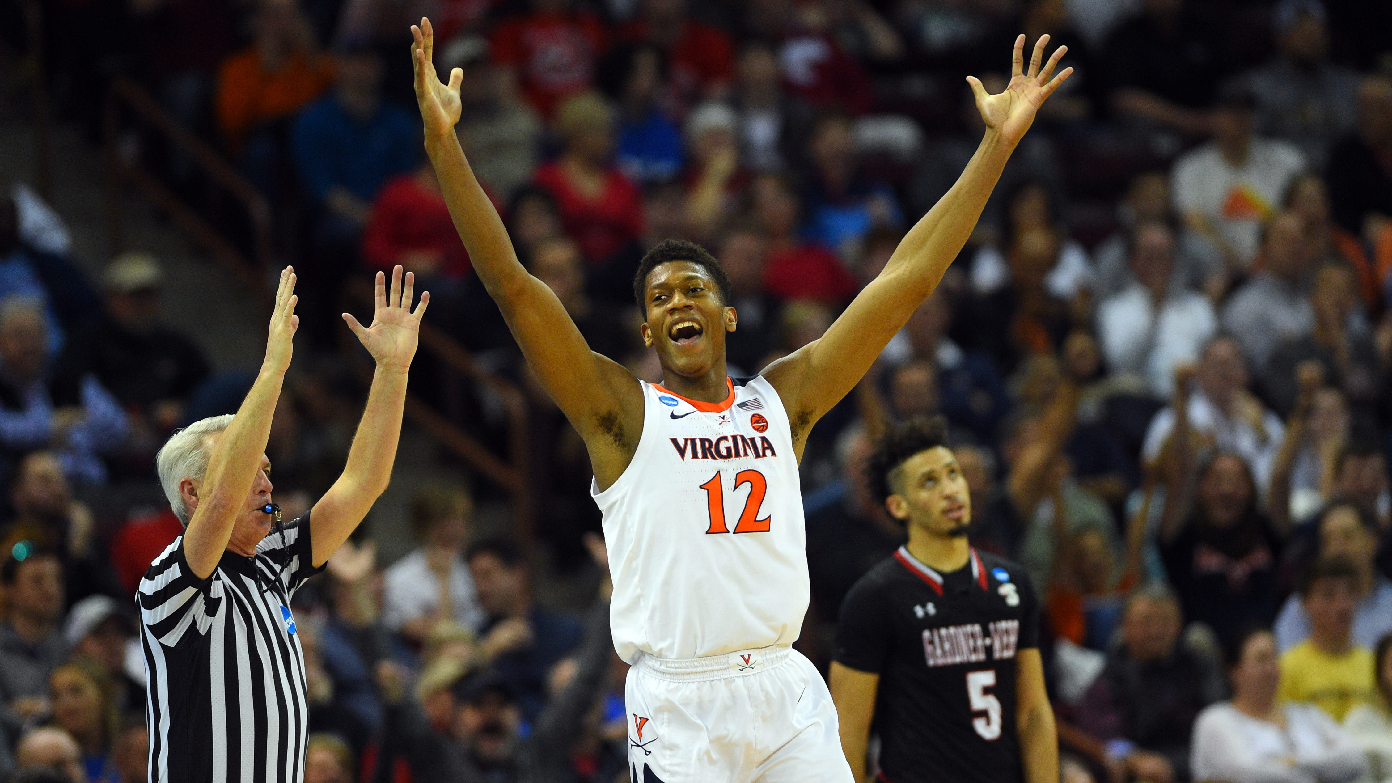 Virginia's De'Andre Hunter celebrates after making a basket during the second half of the Cavaliers' first-round game.
