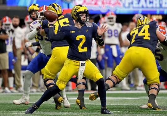 Michigan quarterback Shea Patterson looks to pass during the third quarter against Florida.