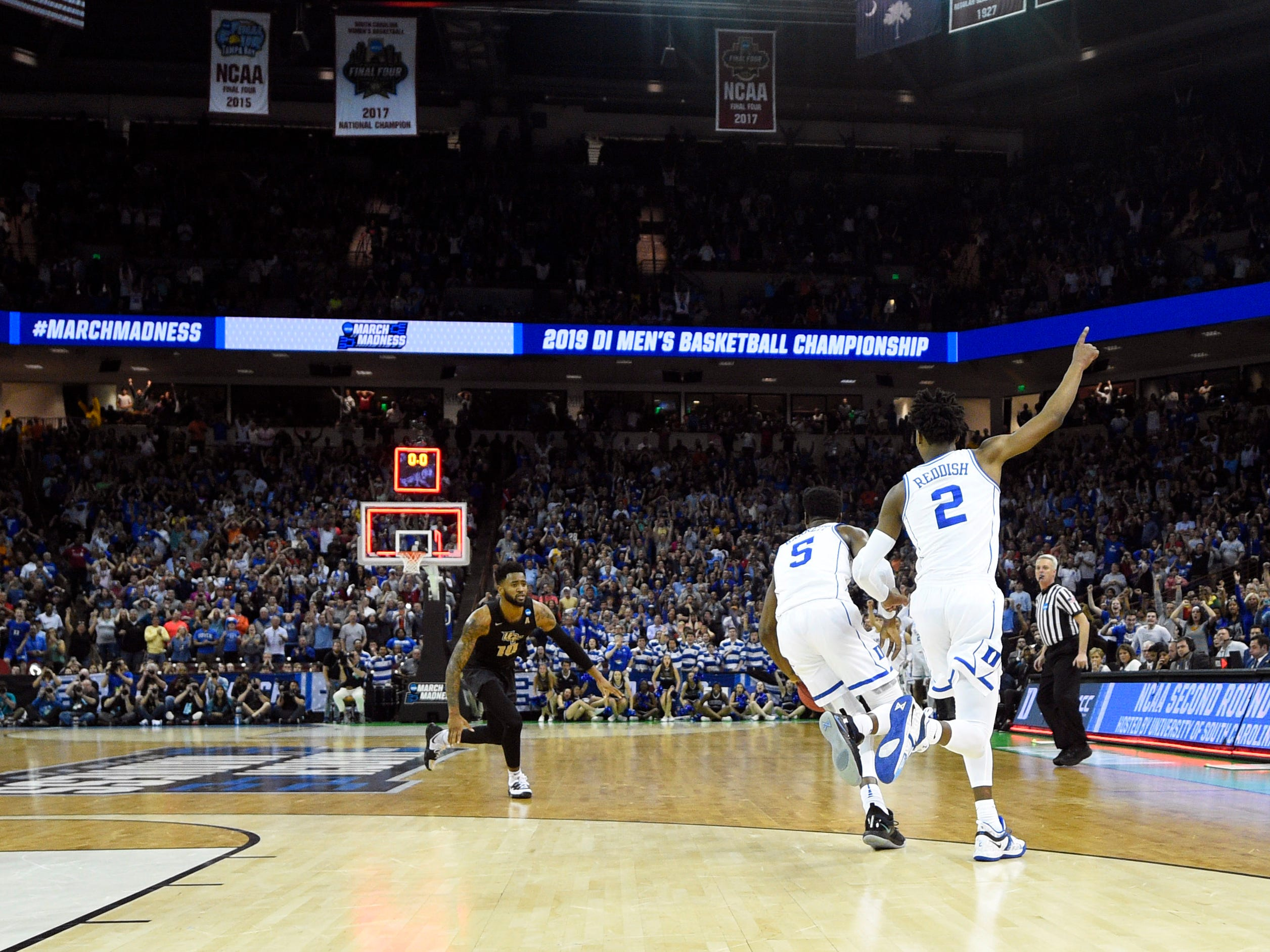 Round of 32: No. 1 Duke celebrates after surviving the final possession in a 77-76 win over No. 9 Central Florida.
