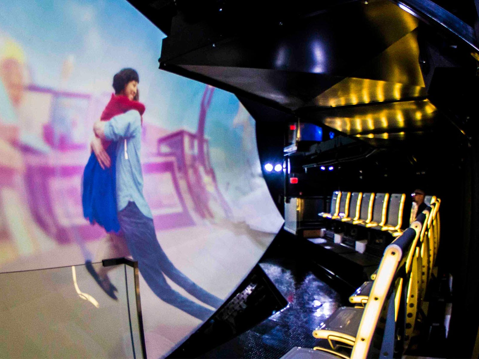 The Flyer's main theater has 28 seats arranged in two levels in front of an enveloping, curved screen. The seats remained tethered to the floor, but each pair has its own actuatorthat allows them to have more freedom of movement than other flying theaters.