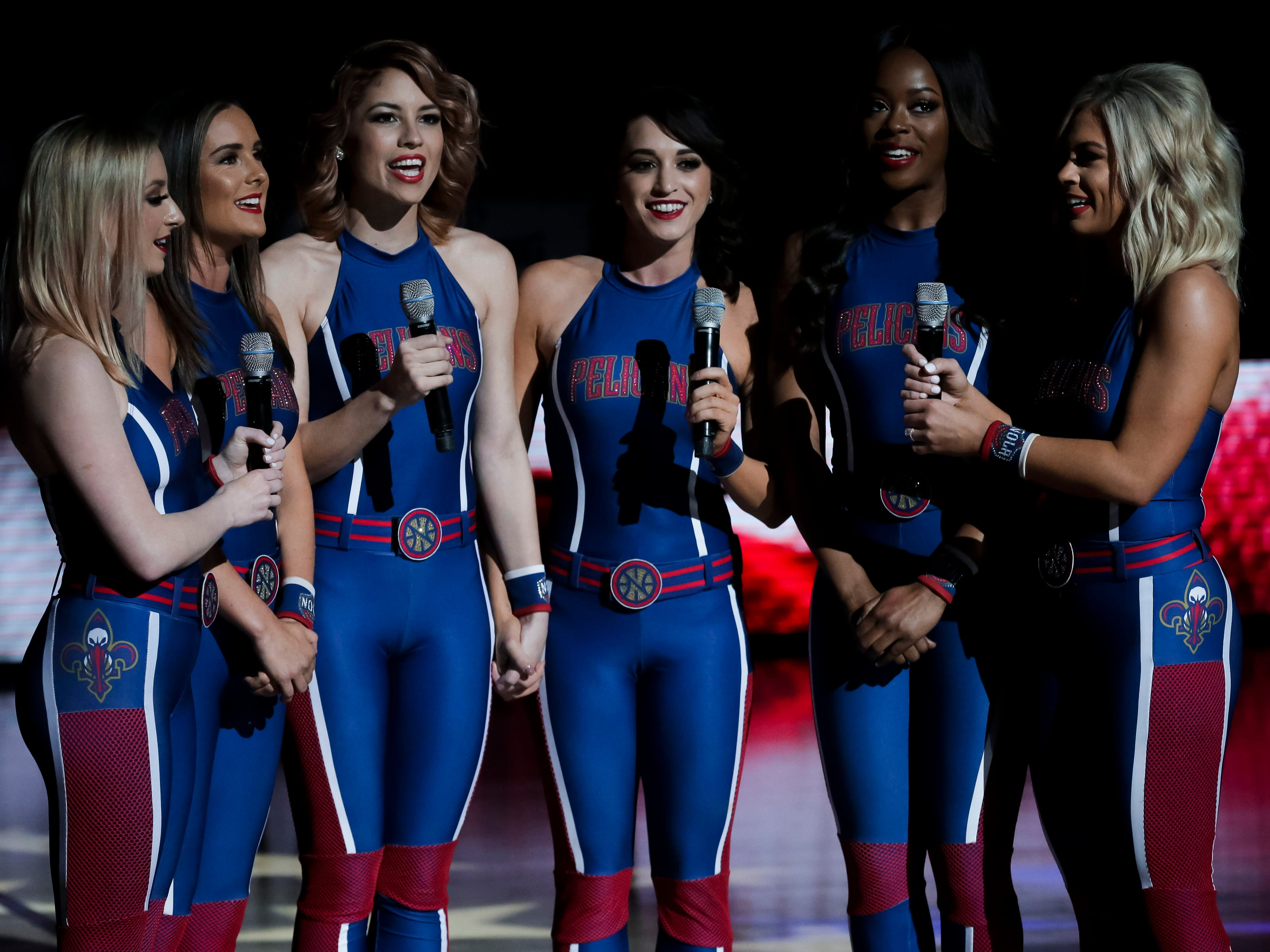 March 24: Members of the Pelicans dance team sing the national anthem before playing the Rockets at the Smoothie King Center in New Orleans.
