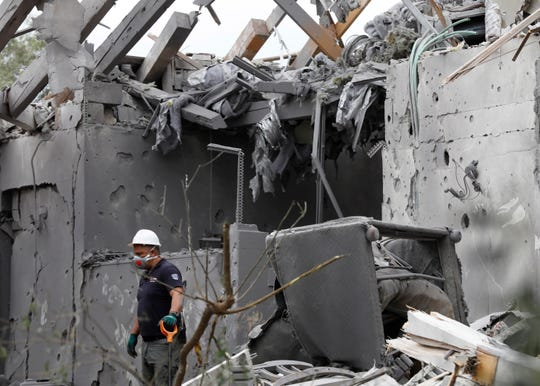 Israeli Police examine a house that suffered a direct hit from a missile reportedly fired by militant groups from the Gaza Strip in Moshav Mishmeret near Netanya, north of Tel Aviv Israel, 25 March 2019.