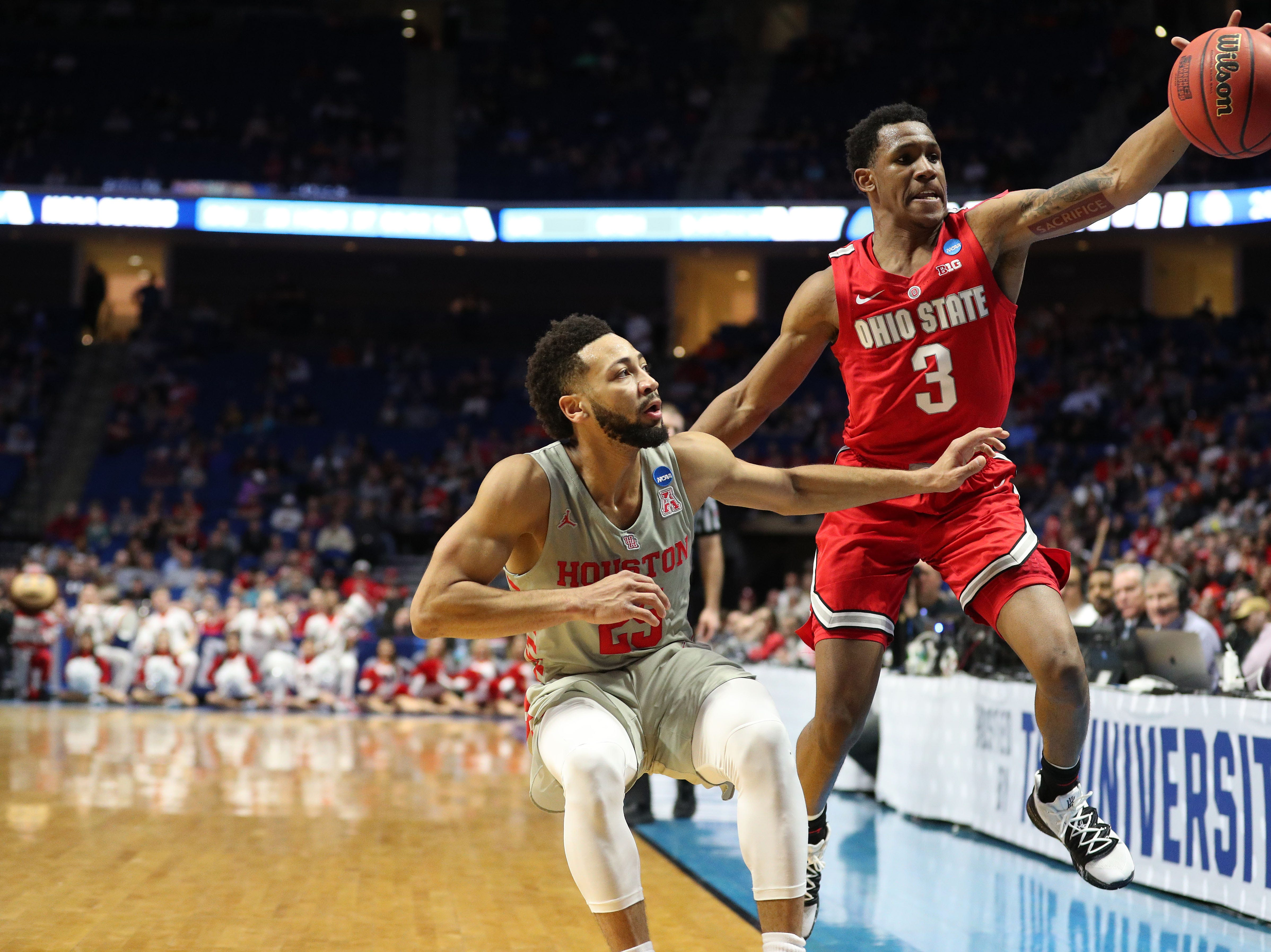 Round of 32: Ohio State Buckeyes guard C.J. Jackson (3) saves the ball from going out of bounds in front of Houston Cougars guard Galen Robinson Jr. (25) during the first half.