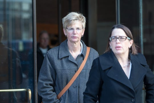 Donna Heinel, former senior associate athletic director at the University of Southern California, leaves following her arraignment at Boston Federal Court on March 25, 2019.