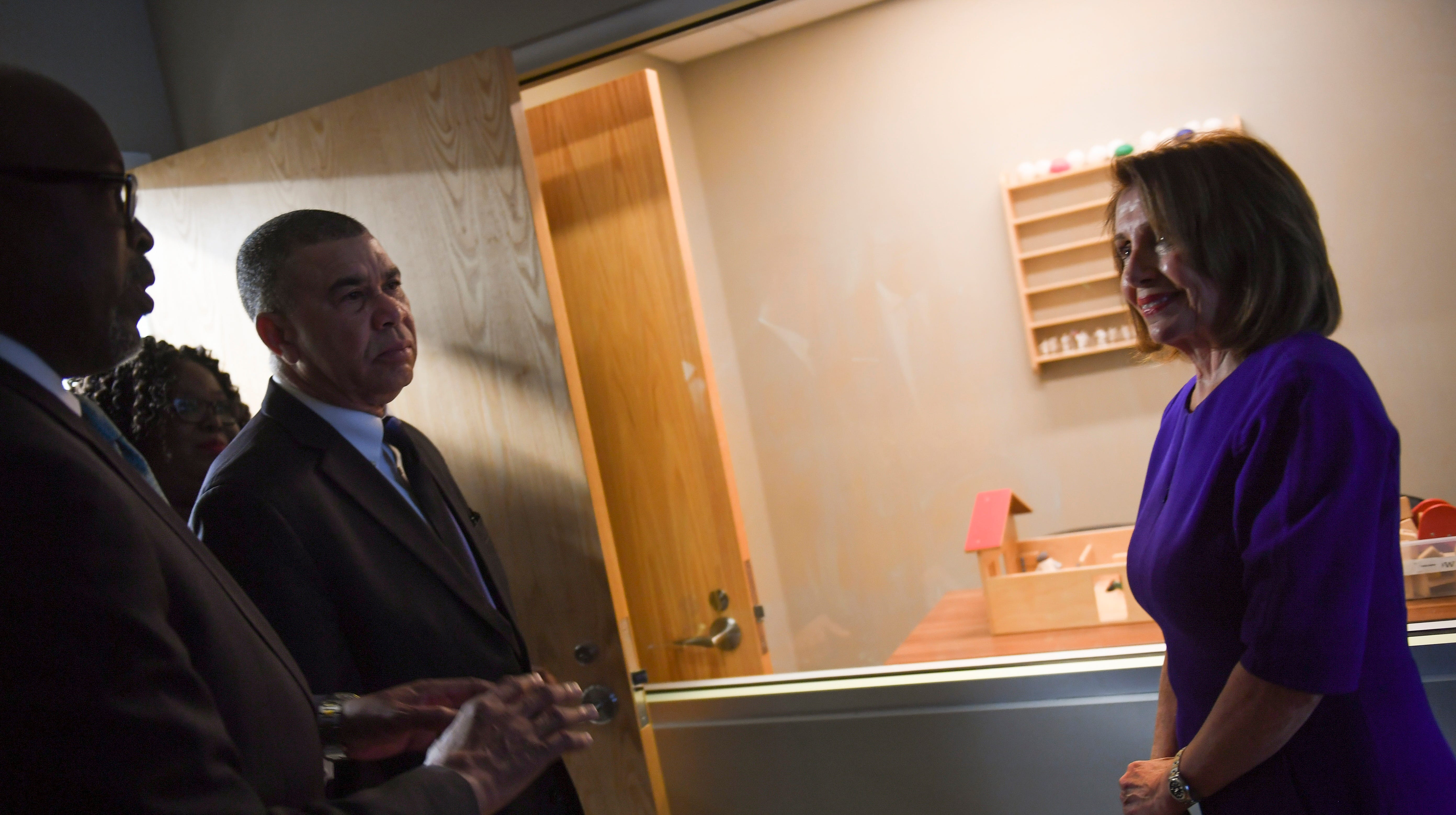 Dwayne Butler (left), president and CEO of the Betty Jean Kerr People's Health Centers, shows Rep. William Lacy Clay (center), D-Mo., and Speaker of the House Nancy Pelosi, during a tour of the of the Lacy Clay Center for Children's Health. Pelosi will have to lead Democrats in a strategy on how to deal with the fallout of the Mueller report.