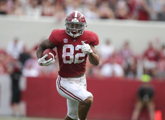 Alabama Crimson Tide tight end Irv Smith Jr. (82) carries the ball against Texas A&M Aggies at Bryant-Denny Stadium.