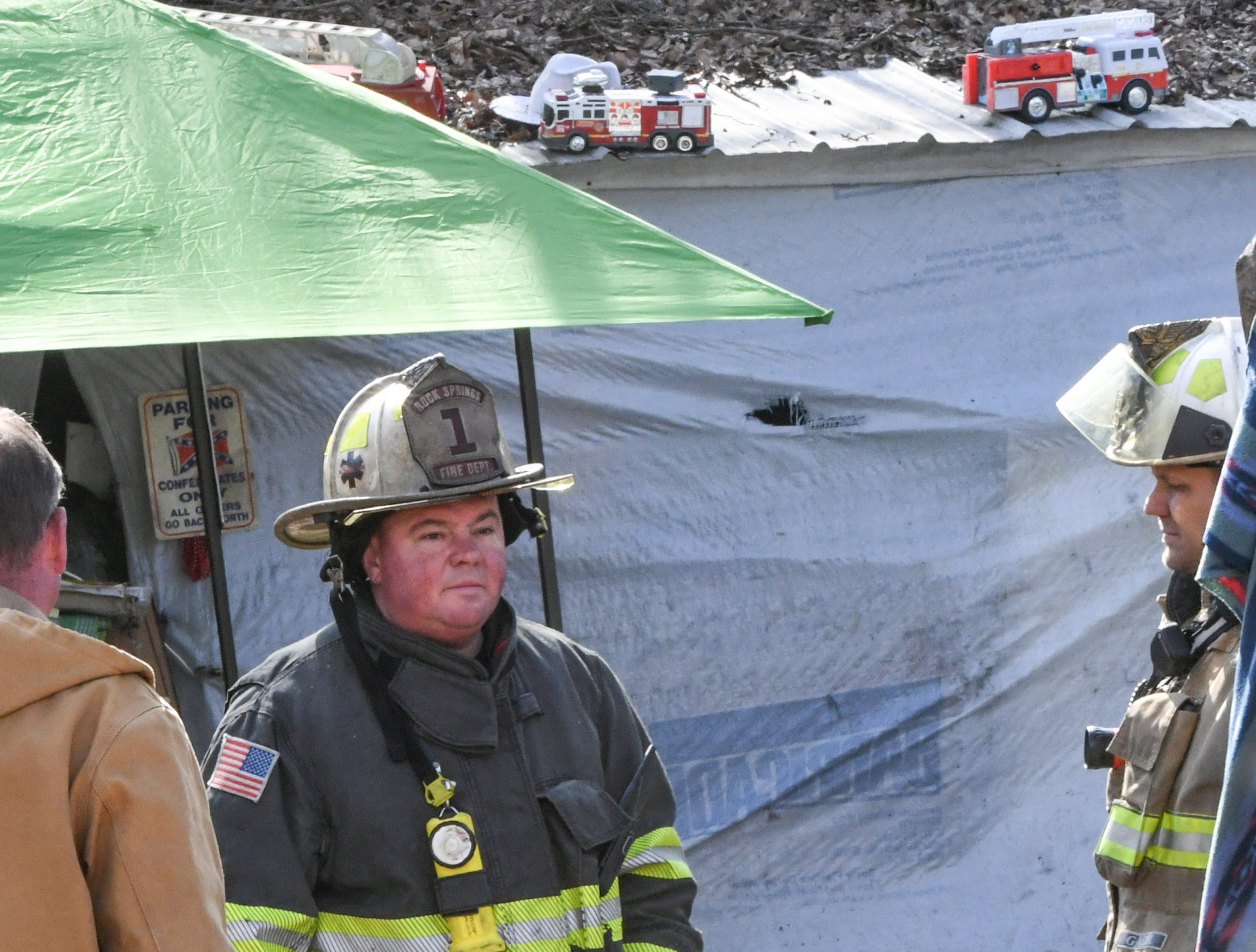 Chief Greg Elgin stands near the home at the 800 block of Brazeale Street in Belton Tuesday, March 26, 2019. The man, woman, and dog at the home were unharmed at the fire which Cheddar fire responded to, with assist from Belton, Rock Springs and Belton EMS. Anderson County fire investigator Wendall Marshall was at the scene of the fire under investigation.