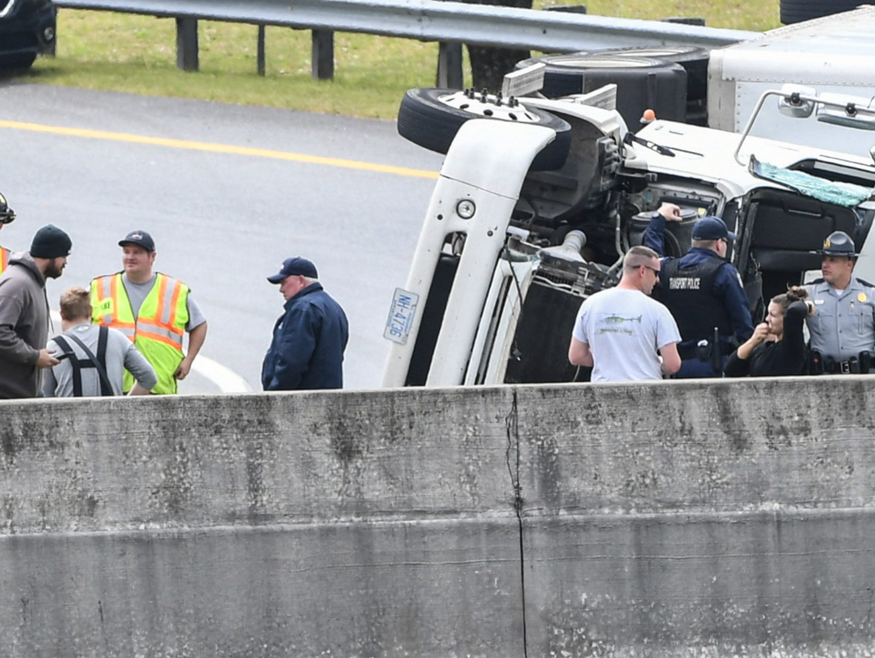 Townville fire and Fork Rescue squad work the scene of a crash with state troopers and transport police, one involving a tractor-trailer on a Interstate 85 Northbound ramp, entered from southbound Clemson Boulevard, in Anderson County Tuesday, March 26, 2019.