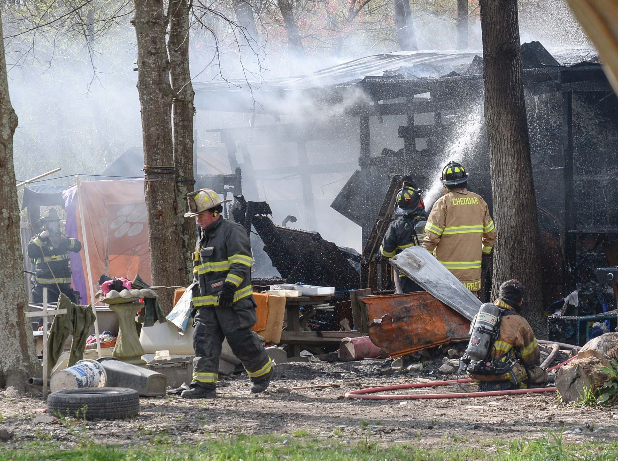 Chief Greg Elgin, left, walks near the house fire at the 800 block of Brazeale Street in Belton Tuesday, March 26, 2019. The man, woman, and dog at the home were unharmed at the fire which Cheddar fire responded to, with assist from Belton, Rock Springs and Belton EMS. Anderson County fire investigator Wendall Marshall was at the scene of the fire under investigation.
