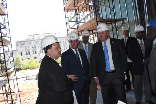 Jimmy Sawtelle (left) chancellor of CLTCC, gives Gov. John Bel Edwards (center) and state Rep. Jay Luneau (right) and other dignitaries including Alexandria city councilman Ed Larvadain; Monty Sullivan, president of Louisiana's Community and Technical Colleges System; Alexandria mayor Jeff Hall and Pineville mayor Clarence Fields, a tour of the new downtown buildings which are currently under construction.